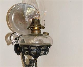 Antique oil lamp with wall bracket and reflector