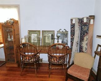 Narrow oak display cabinet(16 x 64 x 12). Vintage console table. Two Windsor style chairs:HAVE BEEN REMOVED BY THE FAMILY. One room size braided rug and 2 woven rugs.