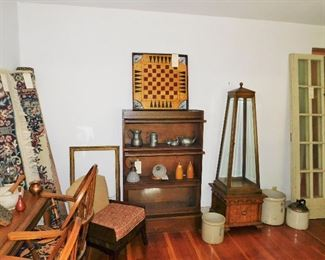 Antique game board, pewter pieces, pair of wall sconces from the C B & Q railroad, S.P. & S. Co. White Hall IL,crocks, trapezoidal display case, pair of antique French doors.