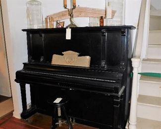 Black antique upright piano
