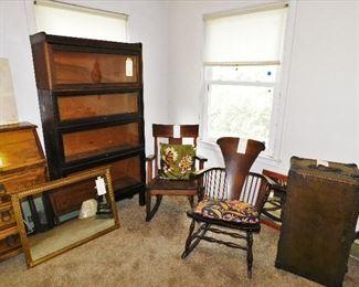4 stack barrister. Arts and Crafts oak rocker. Spindle back rocker. Antique mirrors, old trunk.