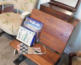 Upholstered arm chair. Antique school desk. Vintage Christmas ornaments.