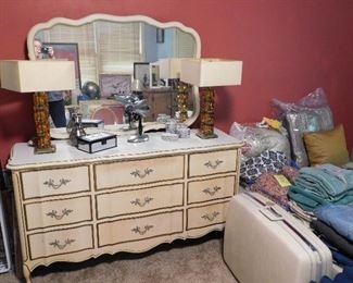 Vintage dresser with mirror. Vintage hair dryer with stand. Pair of vintage glass-block lamps. Nice old Samsonite suitcase.
