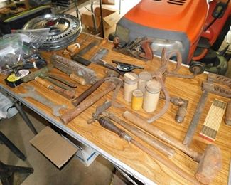 Old tools, beat up hubcaps, etc.