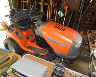 Older Husqvarna riding mower. Runs great, cuts grass! There are 3 soaker hoses on the seat.