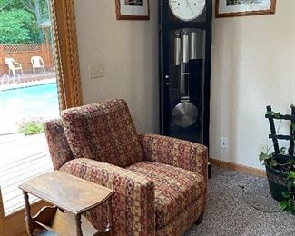 Howard Miller Westminster chime 8-day clock, Recliner, Side table (with lower book rack), Framed James Keating pictures on the wall