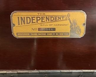 """""""The Independent"""" phonograph.  This metal tag is under the lid and visible when open"""