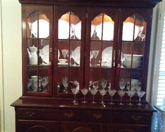 Mahogany Lighted China Cabinet with beautiful china & crystal stemware.