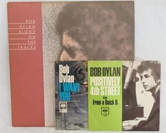 1006 1006ORIGINAL BOB DYLAN BLOOD ON THE TRACKS ALBUM WITH NOTES FROM PETE HAMIL & TWO BOB DYLAN  45S