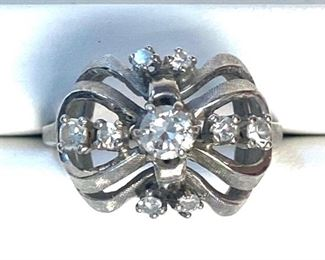 14KT White gold cast diamond ring with a Florentine finish. It contains a transitional cut diamond with an approximate weight of 0.39ct. it also has eight prongs that single cut diamonds for approximate total weight of the eight stones equaling 0.41ct.