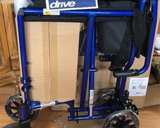 Brand new in box DRIVE lightweight transport wheel chair