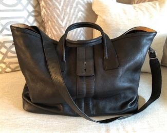 TOD's black leather duffel / top handle tote with tan interior accents