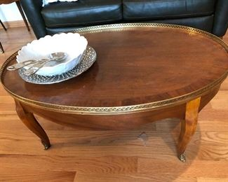 vintage Baker Furniture oval coffee table with brass accents and matching side table