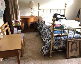 Vintage brass full bed frame, lighted oak wash stand with leaded doors, vintage school desk.