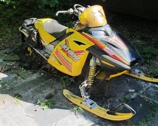 Ski-doo Snowmobile.  BID ONLINE at https://narhiauctions.hibid.com/auction/231629/online--robert-j--strong-estate/