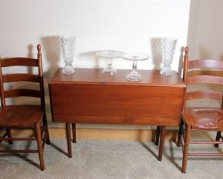 Spectacular Cherry Dining Table with 14 Chairs and Extension that Doubles as Drop Leaf Side Table.  There are 8 Captain's Chairs and 4 Side Chairs.  Amish Style Made in USA.