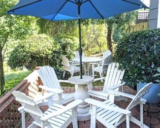 Set/4 white wooden Adirondack armchairs, with faux concrete umbrella stand and nice blue umbrella.