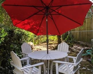 Set/4 white wood armchairs, with matching table and red umbrella.