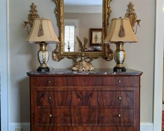 Beautiful Louis Philippe marble-topped 4-drawer walnut chest, antique French gilt wood mirror, flanked with a pair of Italian gilt wood double light wall sconces, pair of MOP/brass table lamps and vintage brass eagle on gilt wood base.