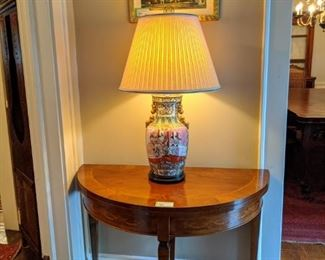 Nice, inlaid wood demilune game table, wth vintage Asian porcelain table lamp.