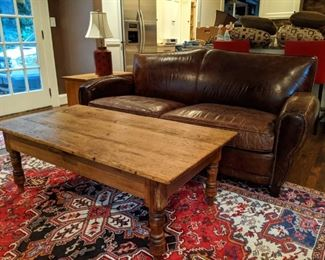 "Nice vintage pine coffee table, atop a hand-woven Persian Heriz wool rug., measuring 7' 4"" x 10' 6""."