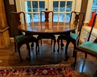 LOVE the size of this vintage mahogany oval breakfast table. It has ALL the right things - pie crust edge, oval shape and large, nicely carved ball and claw feet; set of four matching side chairs.