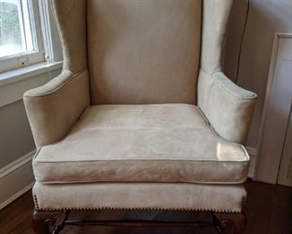 The second pigskin upholstered wingback chair.