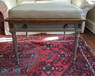 Lovely French leather-topped ottoman, with brass nailheads and single drawer.