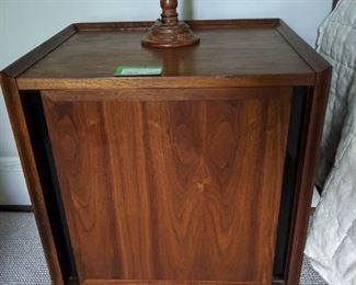 "One of a pair of vintage Dillingham's ""Esprit"" walnut bedside tables.                                                                              Height: 22.63"" Width: 27"" Depth: 15.5"""
