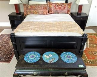 Wonderfully comfortable queen size black wood bed, with headboard/footboard, relatively new pillow-top mattress set, with Ralph Lauren foot warmer and Persian rug remnant pillows, pair of matching bedside tables and amazing Asian cloisonne and lacquered table.