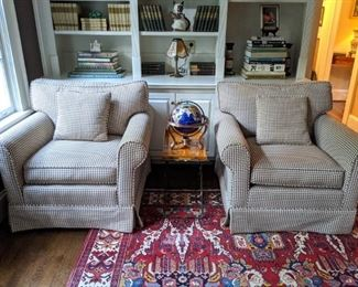 Pair of amazingly comfortable houndstooth upholstered armchairs, tole side table, gemstone globe and tons of books on the shelves behind.