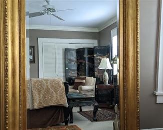 "HUGE gold gilt wood mirror, with beveled glass- bring a crane - this thing is HEAVY!!                                          Measures 6' 4""T x 4' 9""W."