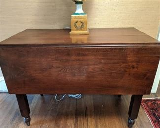 Vintage drop-leaf wooden table.