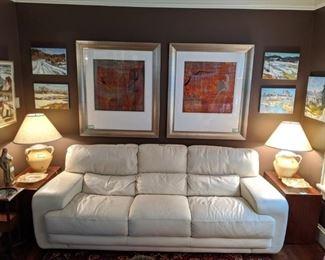 Wonderfully MCM/contemporary style Italian white leather sofa, by Sofitalia, with pair of vintage MCM walnut side table, by Dillingham's Furniture Co., of Sheboygan, WI (est. 1857) pair of butter yellow Grecian urn style table lamps and wall of original artwork, by Russian artists.