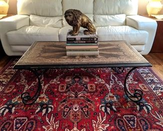 "Vintage mosaic stone coffee table, with cast iron base, atop a perfectly lovely hand-woven Persian Bakhtiari rug, measuring 7' 3"" x 10' 9""."