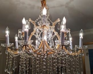 All well-lit by the 13-light Maria Theresa Italian crystal chandelier.