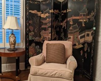 One of a pair of very comfy armchairs and vintage 6-panel hand-carved/painted (both sides) Asian wooden screen and one of a pair of Italian Biedermeier style round side tables.