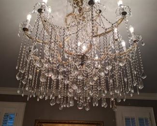 The master bedroom is well lit with this magnificent 16-light Italian Murano crystal chandelier.