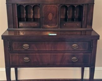 1940's mahogany tambour-door writing desk, w/pencil inlay.