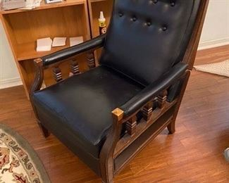 82.Black Faux Leather & Wood Recliner  $60
