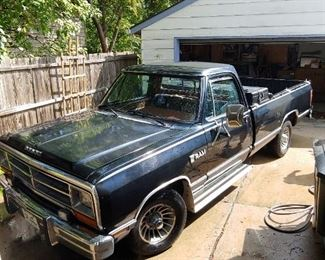 1986 DODGE RAM 150 ROYAL SE.  2 WHEEL DRIVE V8 360 ENGINE.   VERIFYING MILEAGE.  FAMILY STATED IT IS ON ITS 3RD ENGINE.  DRIVER SEAT PICTURE FORTHCOMING.  FABRIC TEARS COVERED WITH DUCT TAPE.    ASKING $8.500
