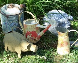 Watering cans, pitcher and concrete piglet