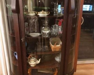Antique beautiful curved front china cabinet original finish and glass.  Mahogany
