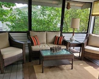 Faux brown wicker with beige cushion patio set: 2 club chairs, loveseat, coffee table and end table