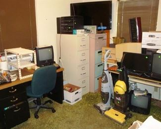 Desk, file cabinets, Flat screen TV, Stereo record player, misc computer equipment, vacuum carpet cleaners.