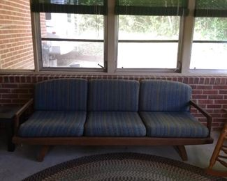 great mid-century sofa on the back porch too