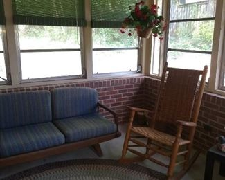 Nice porch rocker & large braided rug on the back porch