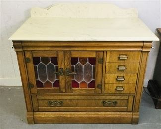 Marble top leaded glass lighted washstand made by Stanley furniture