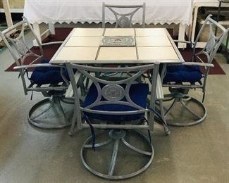 Like new patio set Table & Chairs that swivel & rock with new cushions