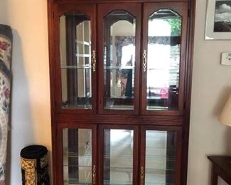 Very nice lighted curio cabinet